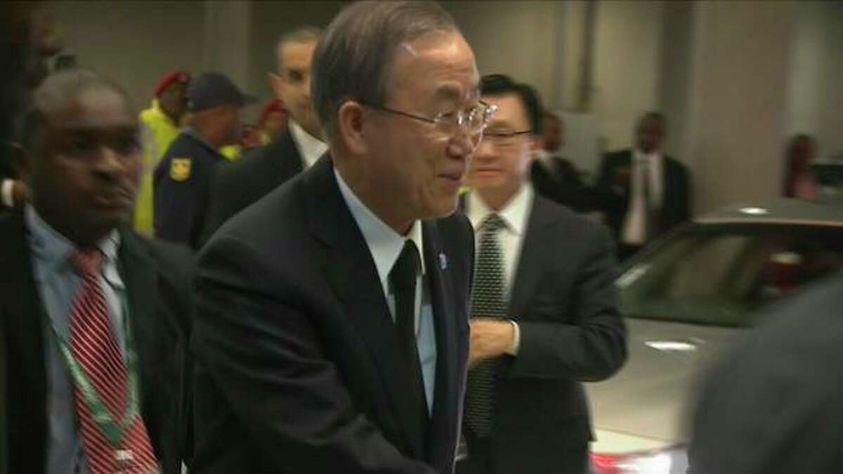 In this image from TV, UN Secretary General Ban Ki-moon, arrives at the FNB Stadium in Soweto, South Africa, ahead of a memorial service for former South African President Nelson Mandela, Tuesday Dec. 10, 2013. Hundreds of foreign dignitaries and world heads of states gather Tuesday with thousands of South African people to celebrate the life, and mark the death, of Nelson Mandela who has became a global symbol of reconciliation. (AP Photo/SABC Pool)