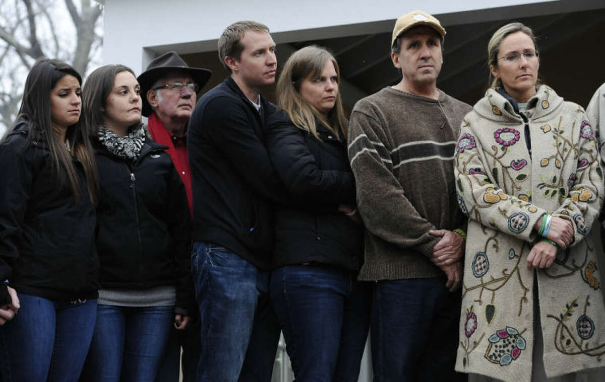 From the left, Carlee Soto, sister of Sandy Hook Elementary School shooting victim Victoria Soto, Erica Lafferty and George Hochsprung, daughter and husband of victim Dawn Hochsprung, Robbie and Alyssa Parker, parents of Emilie Parker, and Neil Heslin and Scarlett Lewis, parents of Jesse Lewis, stand with other family members as they address media, Monday, Dec. 9, 2013, in Newtown, Conn. Newtown is not hosting formal events to mark the anniversary Saturday. (AP Photo/Jessica Hill)