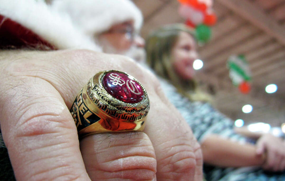 In Nov. 29, 2013 photo taken from video, a gold Santa Claus ring shines on the hand of