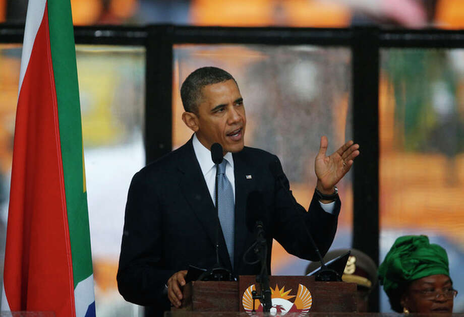 President Barrack Obama speaks to crowds attending the memorial service for former South African president Nelson Mandela at the FNB Stadium in Soweto near Johannesburg, Tuesday, Dec. 10, 2013. (AP Photo/Matt Dunham) / AP