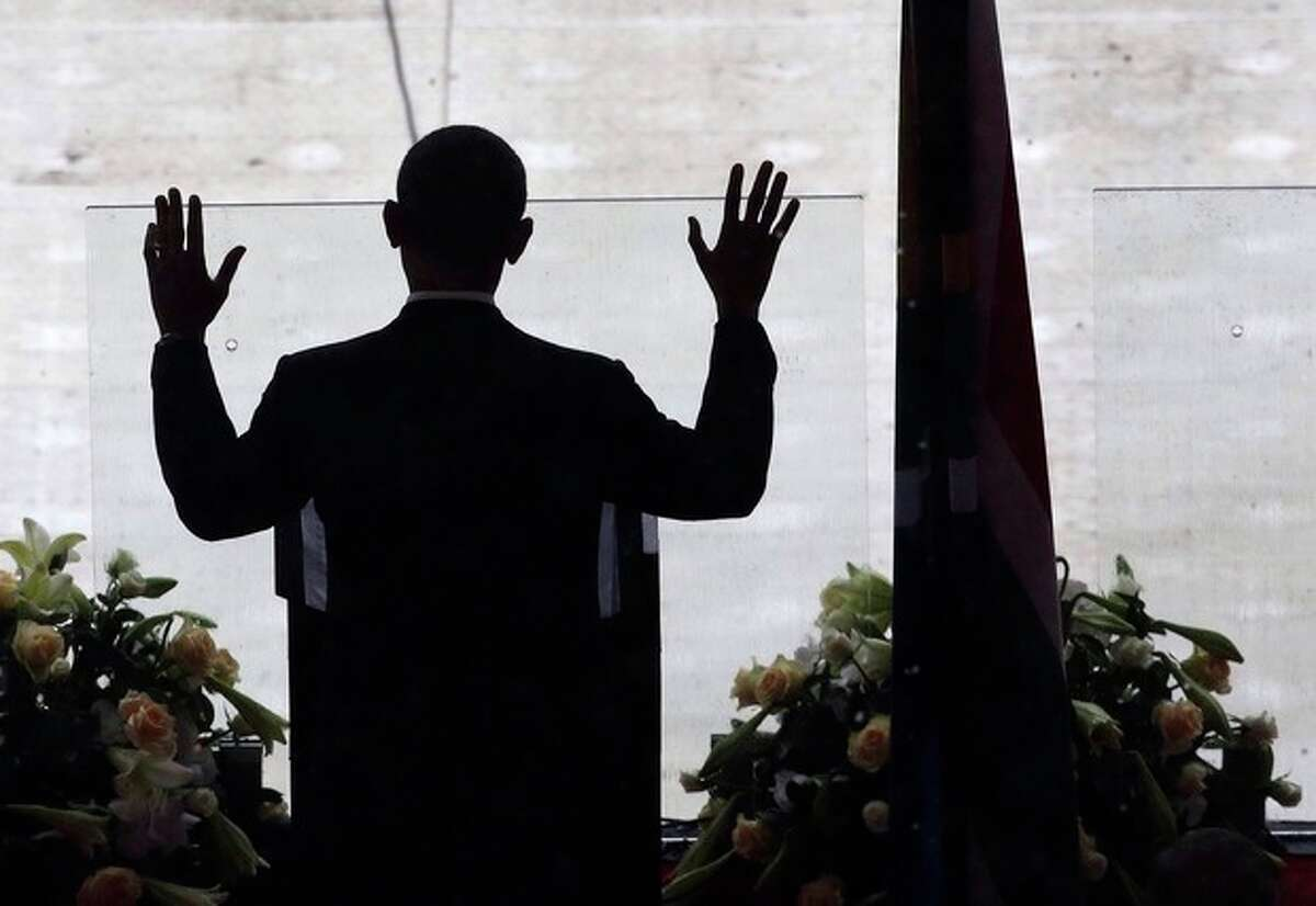 President Barrack Obama gestures as he speaks on stage during the memorial service for former South African president Nelson Mandela at the FNB Stadium in Soweto, near Johannesburg, South Africa, Tuesday Dec. 10, 2013. (AP Photo/Markus Schreiber)