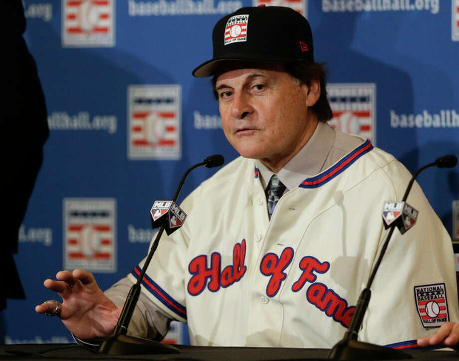 Tony La Russa answers questions at a news conference after it was announced that he, Bobby Cox, and Joe Torre were unanimously elected to the baseball Hall of Fame, at the MLB winter meetings in Lake Buena Vista, Fla., Monday, Dec. 9, 2013. Torre and Cox retired as managers after the 2010 season and La Russa after leading St. Louis to the 2011 championship. Torre won four World Series titles with the Yankees, La Russa three with Oakland and the Cardinals, and Cox one with Atlanta. (AP Photo/John Raoux) / AP