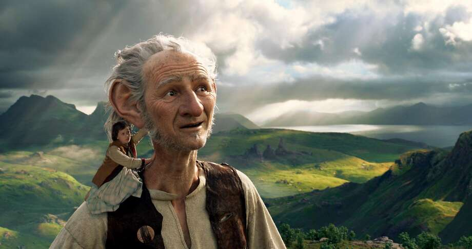 Sophie meets a friendly giant, and some not-so-good-natured ones, in Steven Spielberg's adaption of the Roald Dahl story. Photo: Disney Enterprises