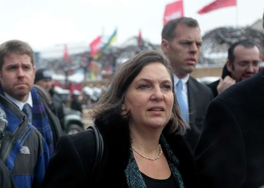 U.S. Assistant Secretary for European and Eurasian Affairs Victoria Nuland, foreground, walks through the Independence Square in Kiev, Ukraine, Tuesday, Dec. 10, 2013. Top Western diplomats headed to Kiev Tuesday to try to defuse a standoff between President Viktor Yanukovych's government and thousands of demonstrators, following a night in which police in riot gear dismantled protesters' encampments outside government buildings. (AP Photo/Sergei Chuzavkov) / AP