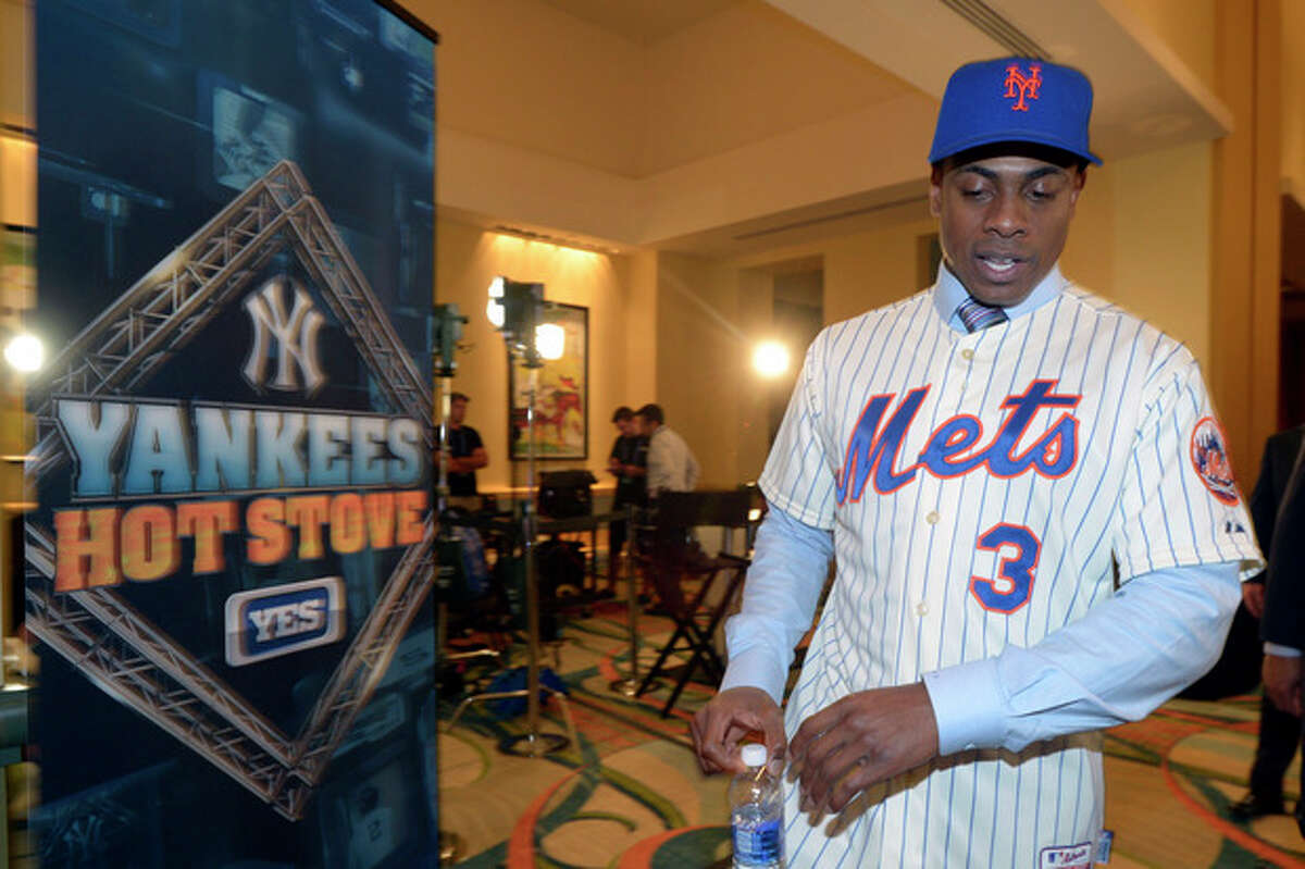New York Mets newest outfielder Curtis Granderson leaves a news conference after his introduction at baseball's winter meetings in Lake Buena Vista, Fla., Tuesday, Dec. 10, 2013.(AP Photo/Phelan M. Ebenhack)