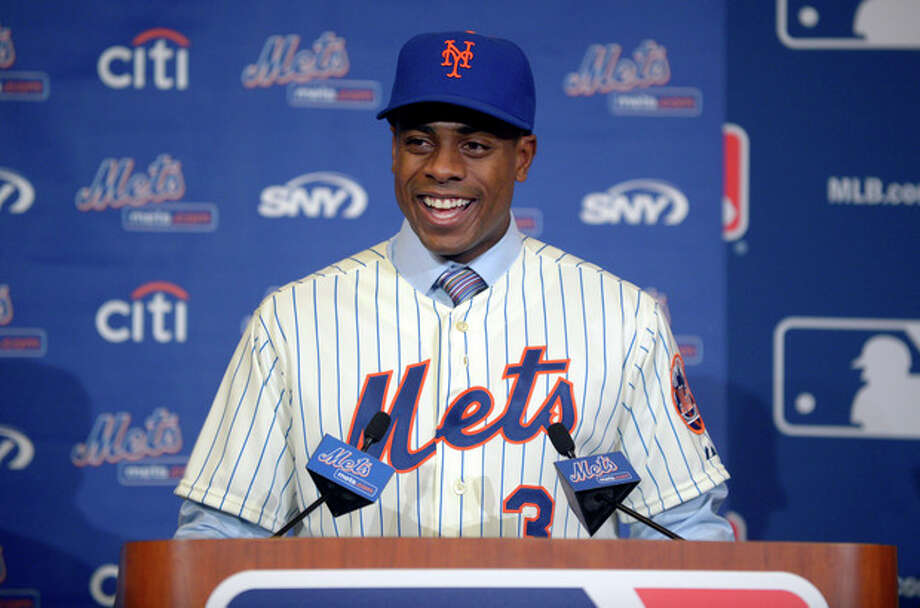 New York Mets outfielder Curtis Granderson answers a question during a news conference announcing his signing at baseball's winter meetings in Lake Buena Vista, Fla., Tuesday, Dec. 10, 2013.(AP Photo/Phelan M. Ebenhack) / FR121174 AP
