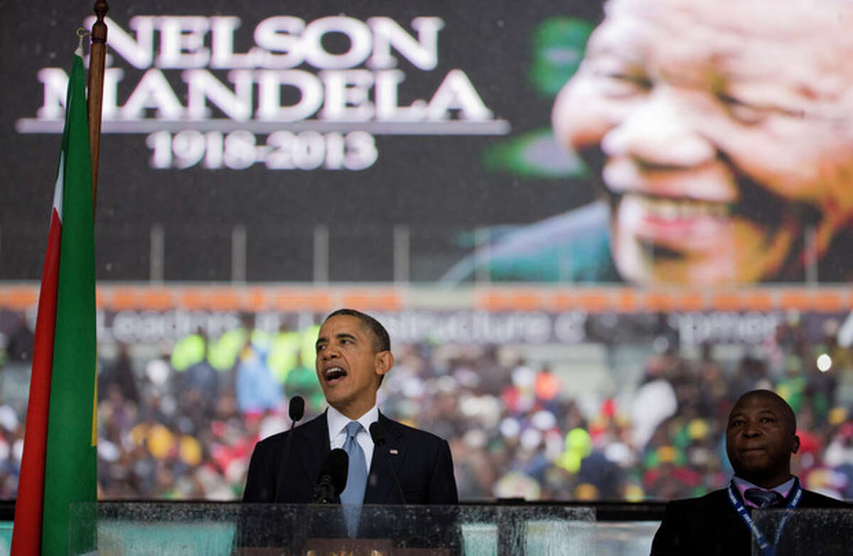 President Barack Obama speaks to crowds attending the memorial service for former South African president Nelson Mandela at the FNB Stadium in Soweto near Johannesburg, Tuesday, Dec. 10, 2013. World leaders, celebrities, and citizens from all walks of life gathered on Tuesday to pay respects during a memorial service for the former South African president and anti-apartheid icon. (AP Photo/Evan Vucci)