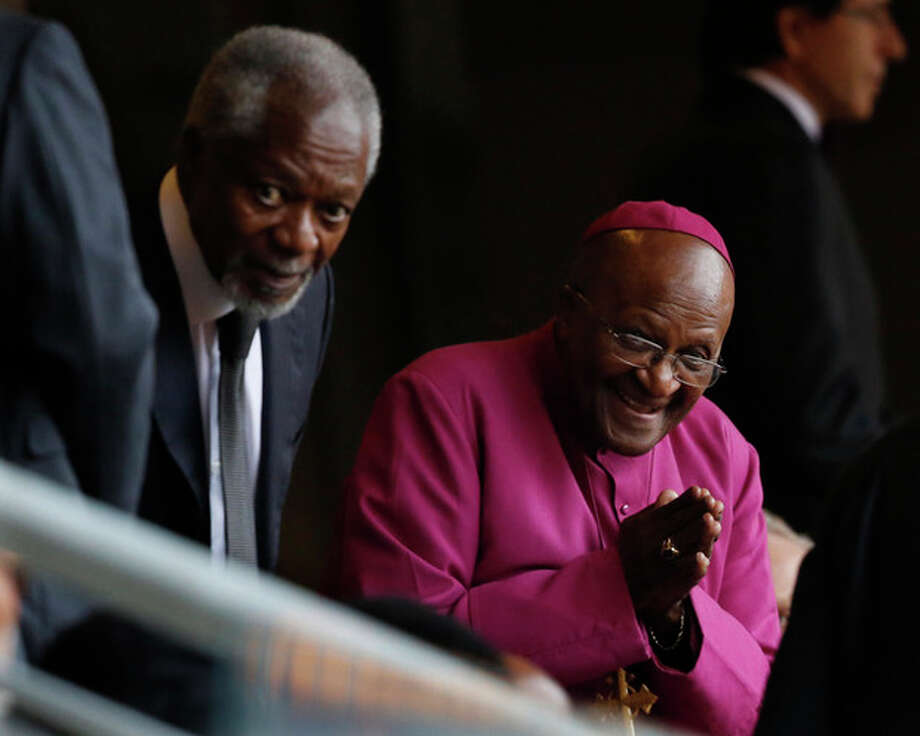 Retired Anglican Archbishop Desmond Tutu, right, arrives with Former U.N. Secretary-General Kofi Annan for the memorial service for former South African president Nelson Mandela at the FNB Stadium in Soweto near Johannesburg, Tuesday, Dec. 10, 2013. (AP Photo/Ben Curtis) / AP