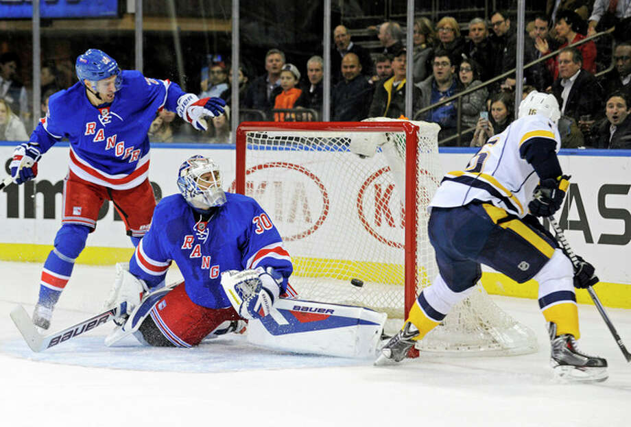 Nashville Predators' Rich Clune, right, scores a goal past New York Rangers goaltender Henrik Lundqvist (30), of Sweden, during the first period of an NHL hockey game Tuesday, Dec. 10, 2013, in New York. (AP Photo/Bill Kostroun) / FR51951 AP
