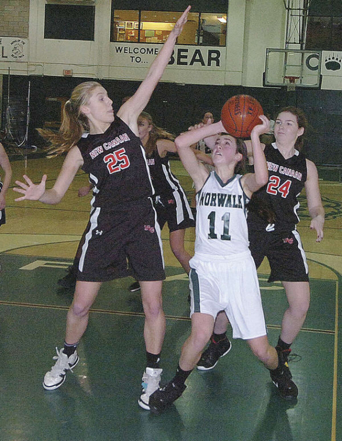 Hour file photo Norwalk's Brianna Fitzgerald looks for a shot during a Feburary game against New Canaan. Fitzgerald is back for a Bears' squad hoping to improve.