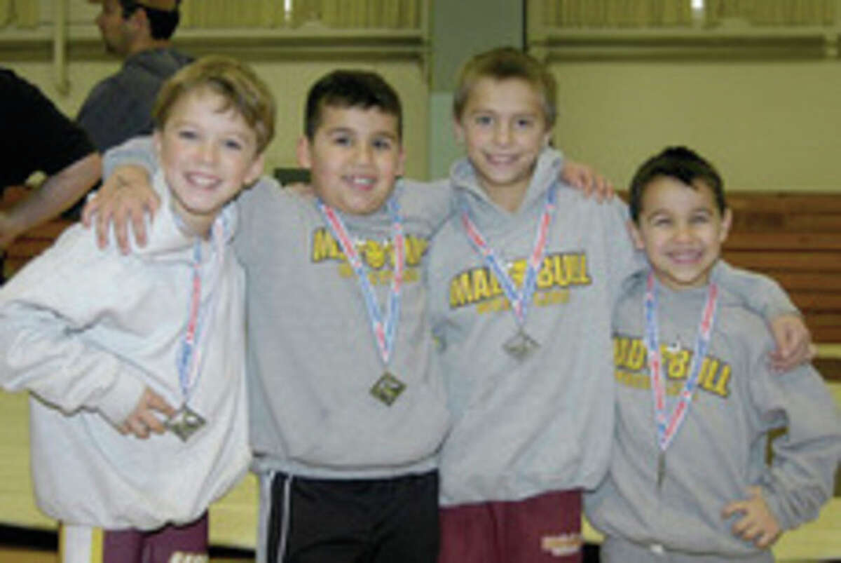 Contributed photo Norwalk Mad Bull youth wrestlers, from left, Jack Cahill, Jason Singer, Mikey Bartush and Nicky Singer each placed first in their respective weight classes at the Connecticut Green Nights Tournament this past Sunday in Terryville. Norwalk's Koy Price, who is missing from the photo, also won his weight class.