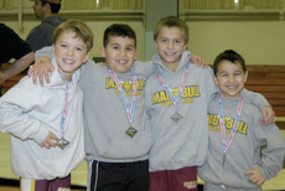 Contributed photoNorwalk Mad Bull youth wrestlers, from left, Jack Cahill, Jason Singer, Mikey Bartush and Nicky Singer each placed first in their respective weight classes at the Connecticut Green Nights Tournament this past Sunday in Terryville. Norwalk's Koy Price, who is missing from the photo, also won his weight class.