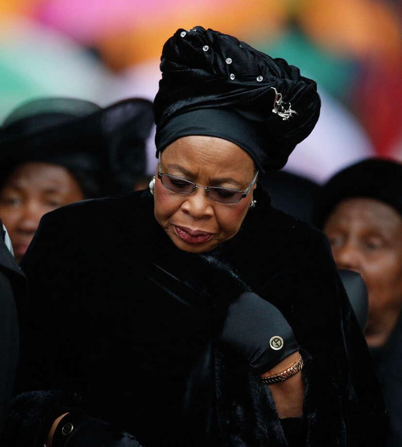 Nelson Mandela's widow Graca Machel lowers her head as she listens to speakers during the memorial service for former South African president Nelson Mandela at the FNB Stadium in Soweto near Johannesburg, Tuesday, Dec. 10, 2013. (AP Photo/Matt Dunham) / AP
