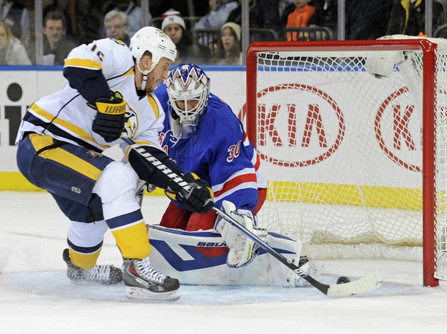 Nashville Predators' Rich Clune, left, scores a goal past New York Rangers goaltender Henrik Lundqvist, of Sweden, during the first period of an NHL hockey game Tuesday, Dec. 10, 2013, in New York. (AP Photo/Bill Kostroun) / FR51951 AP