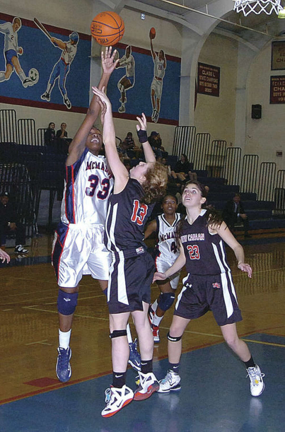Hour file photo Brien McMahon's Jazmine Taylor (33) shoots over a New Canaan defender during a January game. Taylor is one of the top returnees for the Senators.