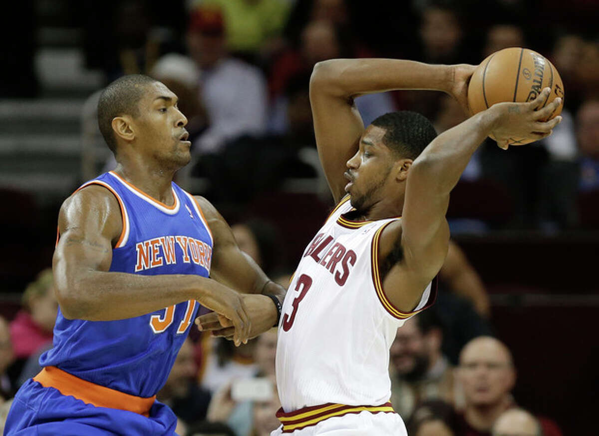 New York Knicks' Metta World Peace, left, defends Cleveland Cavaliers' Tristan Thompson in the first half of an NBA basketball game Tuesday, Dec. 10, 2013, in Cleveland. (AP Photo/Mark Duncan)