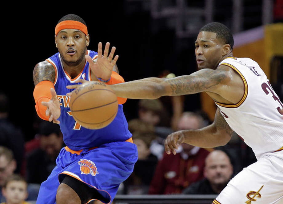 Cleveland Cavaliers' Alonzo Gee, right, knocks the ball away from New York Knicks' Carmelo Anthony in the first quarter of an NBA basketball game Tuesday, Dec. 10, 2013, in Cleveland. (AP Photo/Mark Duncan) / AP