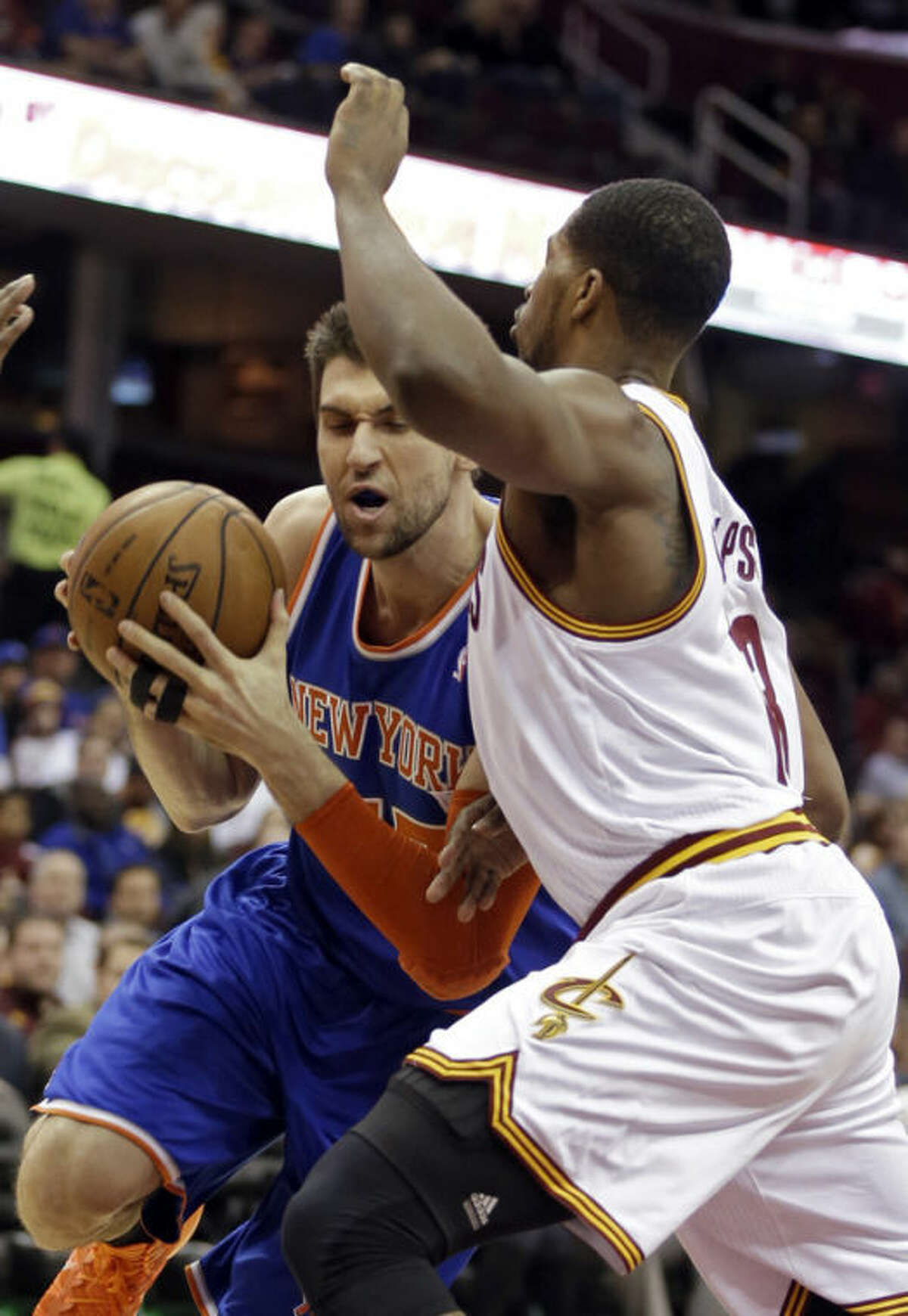New York Knicks' Andrea Bargnani, left, from Italy, drives on Cleveland Cavaliers' Tristan Thompson in the first quarter of an NBA basketball game Tuesday, Dec. 10, 2013, in Cleveland. (AP Photo/Mark Duncan)