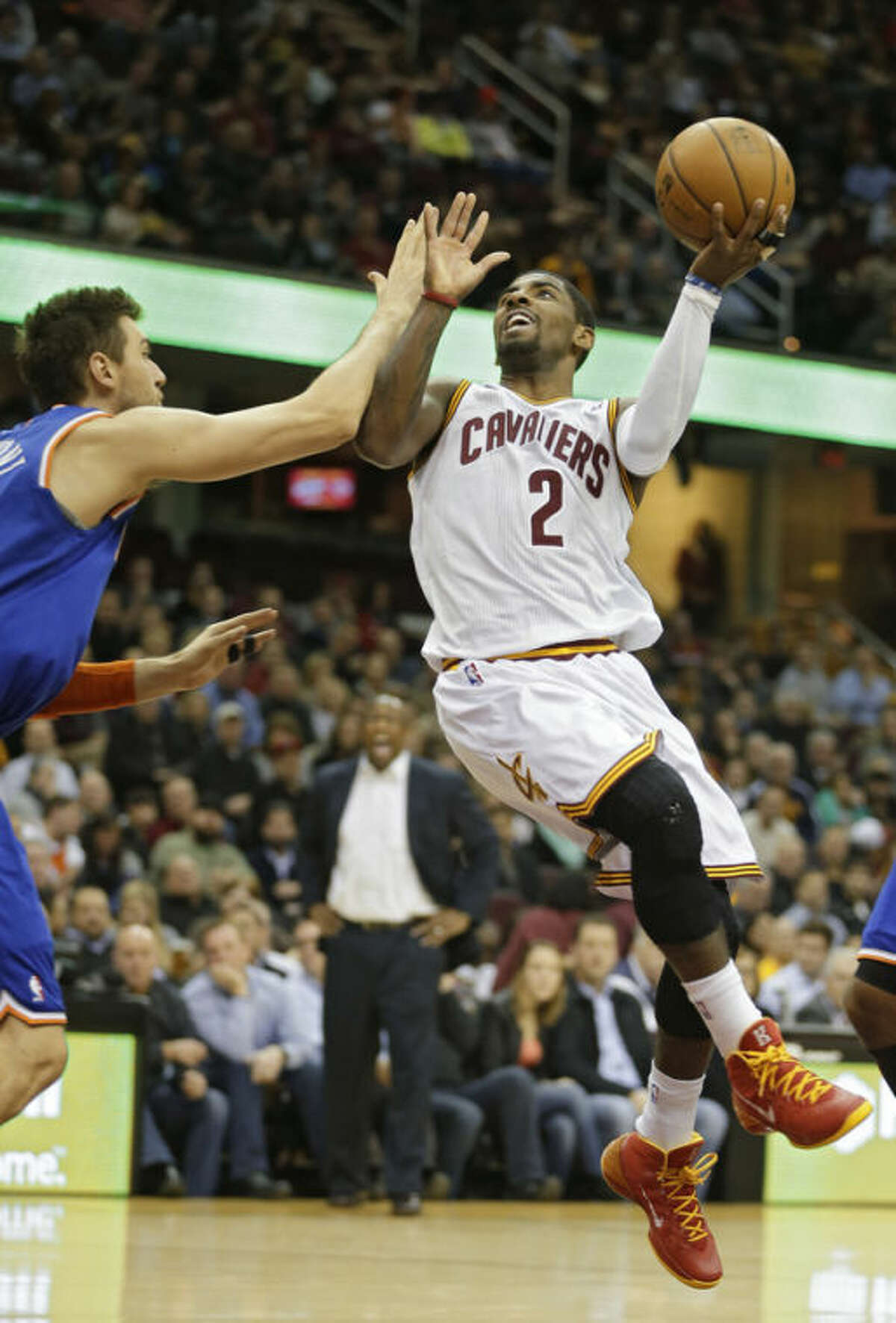 Cleveland Cavaliers' Kyrie Irving (2) shoots against New York Knicks' Andrea Bargnani, from Italy, in the second quarter of an NBA basketball game Tuesday, Dec. 10, 2013, in Cleveland. (AP Photo/Mark Duncan)