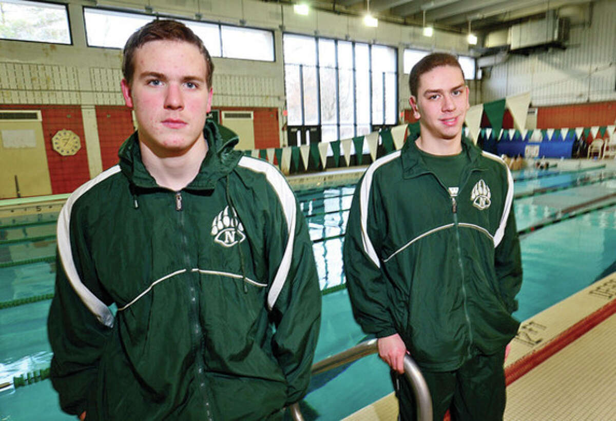 Hour photo/Erik Trautmann Norwalk-McMahon boys swim team co-captains Eddie Donovan and Anthony Dell'Isola will lead the co-op squad into the season, which gets under way next week.