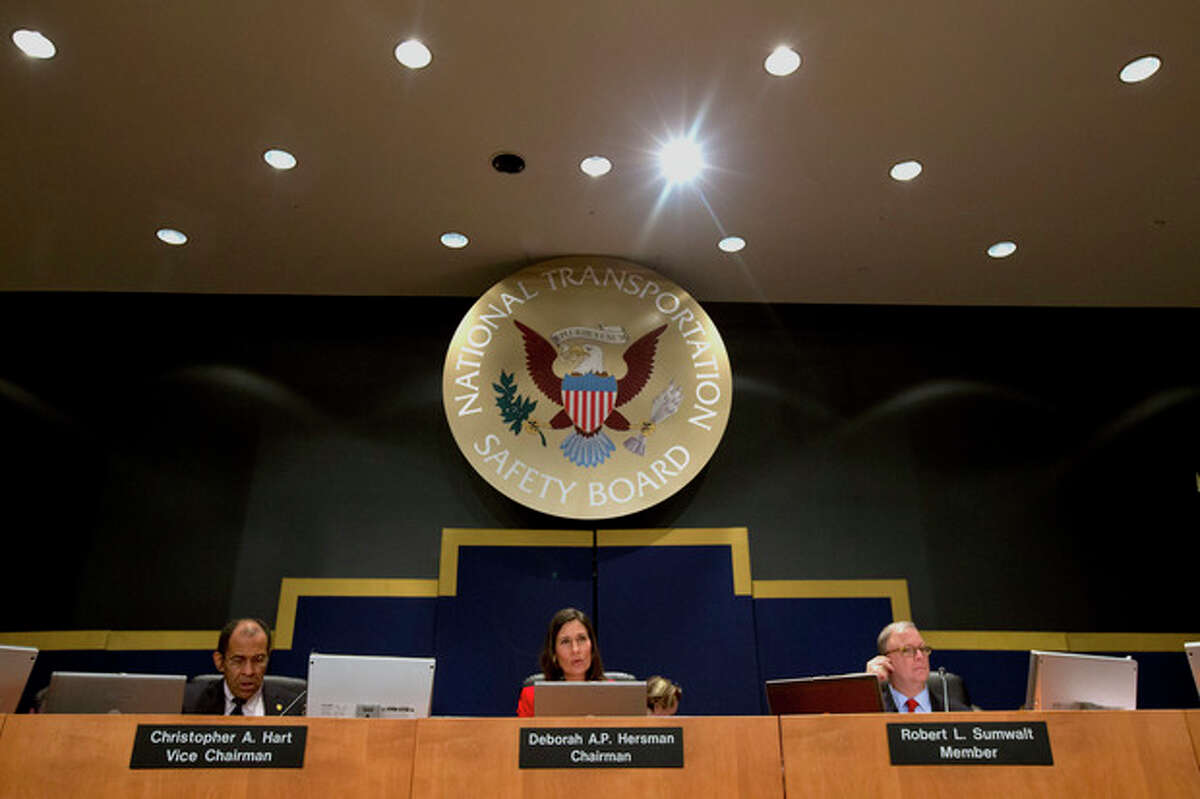 National Transportation Safety Board (NTSB) Vice Chairman Christopher Hart, left, Chair Deborah Hersman, center, and member Robert Sumwalt participate in an investigative hearing in Washington, Wednesday, Dec. 11, 2013, on the crash landing of Asiana Airlines Flight 214. The two-dozen witnesses at the hearing include representatives of Asiana, Boeing Co., the Federal Aviation Administration and the Korean government Office of Civil Aviation. (AP Photo/Jacquelyn Martin)