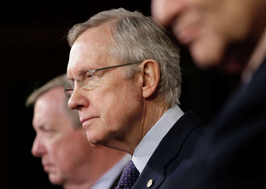 Senate Majority Leader Harry Reid of Nev., center, flanked by Senate Majority Whip Richard Durbin of Ill., left, and Sen. Charles Schumer, D-NY., right, the Democratic Policy Committee chairman, listens during a news conference on budget, Thursday, Dec. 12, 2013, on Capitol Hill in Washington. (AP Photo/Pablo Martinez Monsivais) / AP
