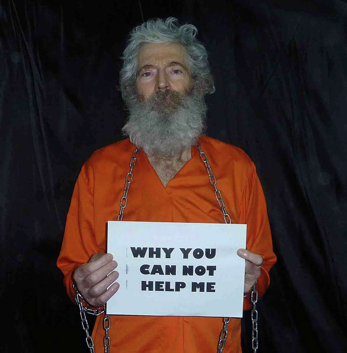 This undated handout photo provided by the family of Robert Levinson, shows retired-FBI agent Robert Levinson in a photo the family received in April 2011. In March 2007, Levinson flew to Kish Island, an Iranian resort. Days later after a meeting with an admitted killer, he vanished. For years the U.S. has publicly described him as a private citizen who was traveling on private business. However, an Associated Press investigation reveals that Levinson was working for the CIA. In a breach of the most basic CIA rules, a team of analysts with no authority to run spy operations, paid Levinson to gather information. But even after the White House, FBI and State Department officials learned of Levinson's CIA ties, the official story remained unchanged. There has been no hint of Levinson's whereabouts since his family received this photo in 2011 and even Iranian President Hassan Rouhani says he has no information about Levinson's whereabouts. (AP Photo/Levinson Family)
