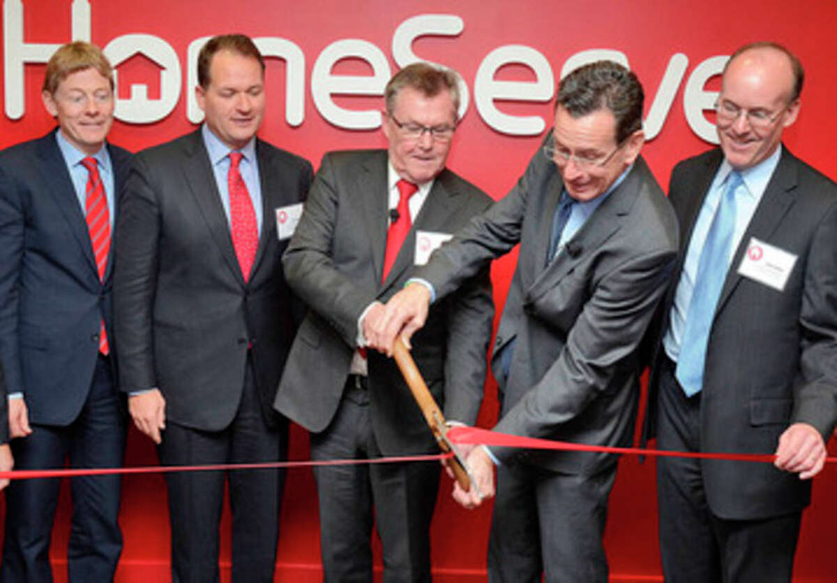 From left, company founder and Global CEO Richard Harpin, U.S. CEO Thomas J. Rusin, Chairman J.M. Barry Gibson, Gov. Dannell P. Malloy and CFO Chris Miller.