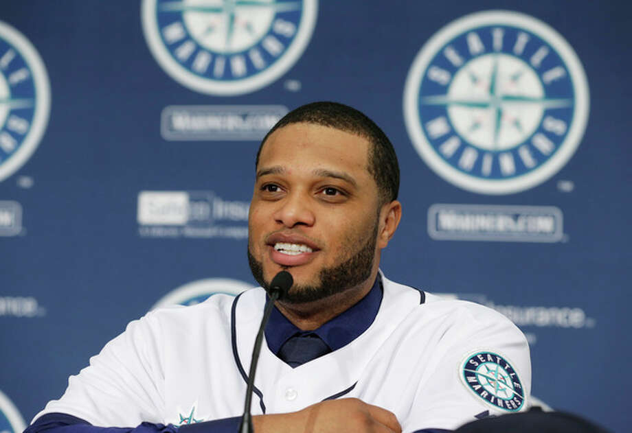 Robinson Cano talks to reporters after he was introduced as the newest member of the Seattle Mariners baseball team, Thursday, Dec. 12, 2013, in Seattle. (AP Photo/Ted S. Warren) / AP