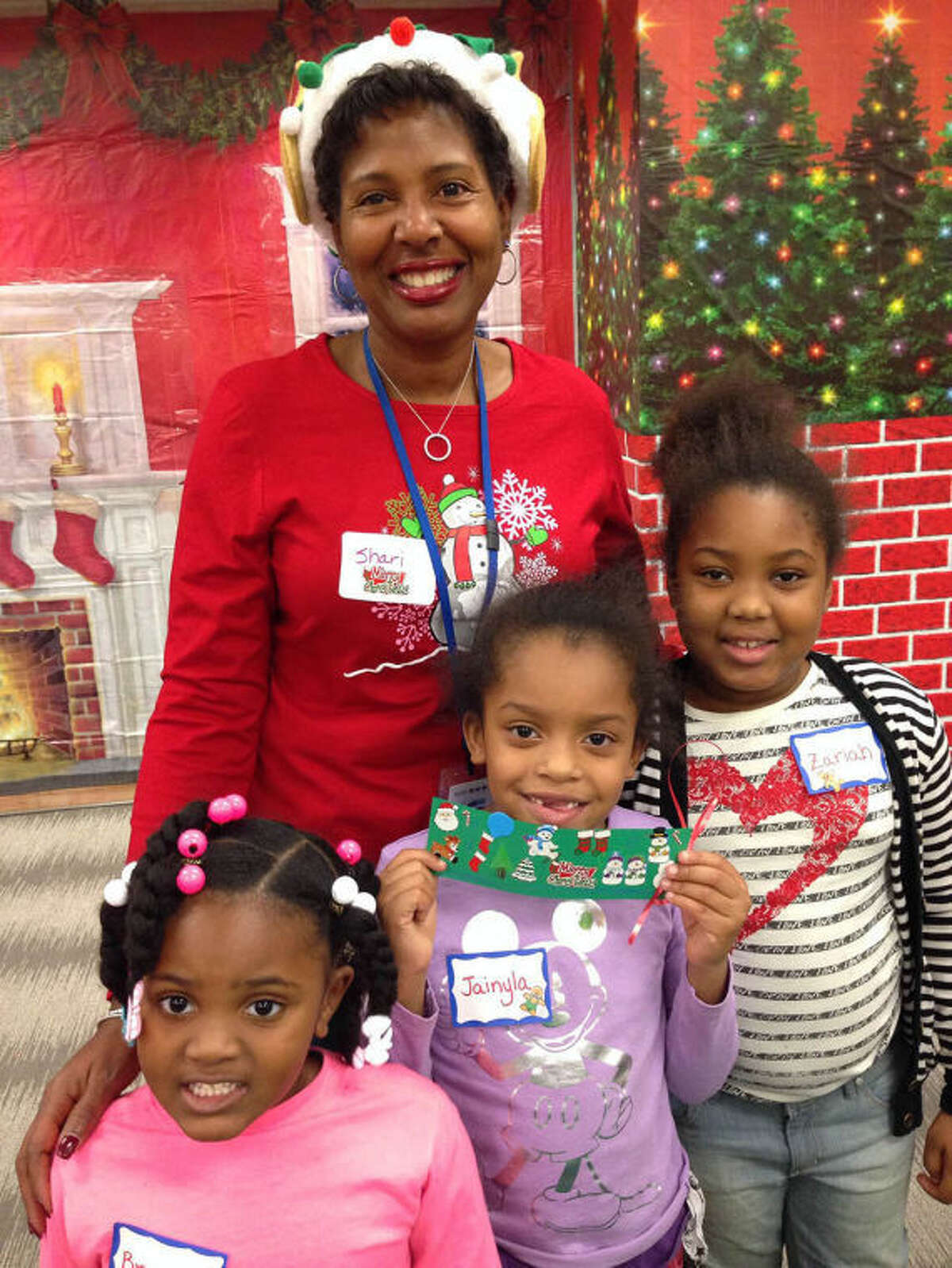 Shari Cole, employee of Beiersdorf, with three winter wonderland helpers.