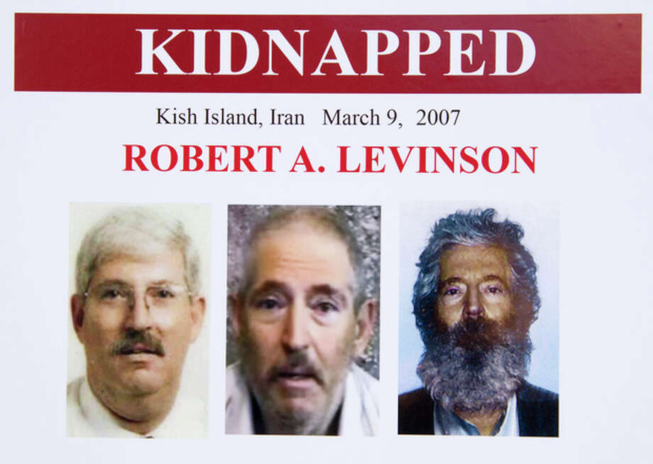 An FBI poster showing a composite image of retired FBI agent Robert Levinson, right, of how he would look like now after five years in captivity, and an image, center, taken from the video, released by his kidnappers, and a picture before he was kidnapped, left, displayed during a news conference in Washington, on March 6, 2012. The FBI announced a reward of up to $1,000,000 for information leading to the safe location, recovery and return of Levinson, who disappeared from Kish Island, Iran, five years ago on March 9, 2007. For years the U.S. has publicly described him as a private citizen who was traveling on private business. However, an Associated Press investigation reveals that Levinson was working for the CIA. There has been no hint of Levinson's whereabouts since his family received proof-of-life photos and a video in late 2010 and early 2011. (AP Photo/Manuel Balce Ceneta) / AP