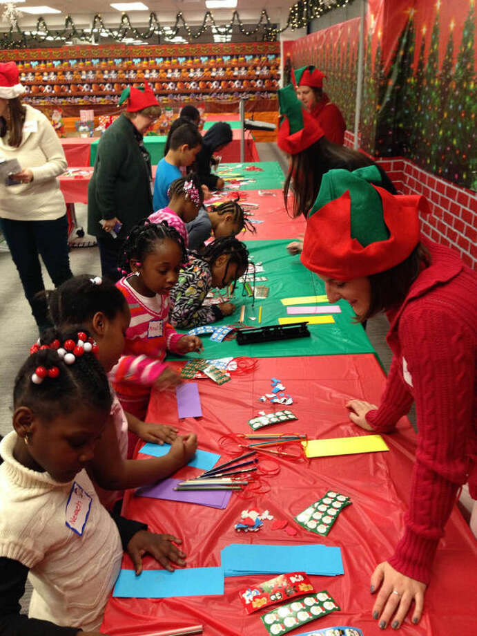 Children make holiday decorations at Beiersdorf holiday party.