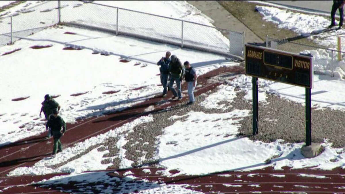 In this still image taken from video provided by Fox 31 Denver, police respond to reports of a shooting at Arapahoe High School in Centennial, Colo. Friday, Dec. 13, 2013. Colorado division of emergency management spokeswoman Micki Trost said her director went to the school and their weren't any more immediate details. (AP Photo/KDVR) MANDATORY CREDIT