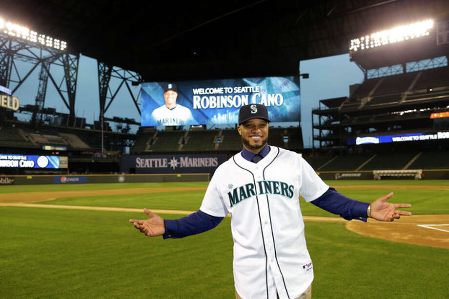 Robinson Cano poses for a photo in his new jersey at Safeco Field after he was introduced as the newest member of the Seattle Mariners baseball team, Thursday, Dec. 12, 2013, in Seattle. (AP Photo/Ted S. Warren) / AP