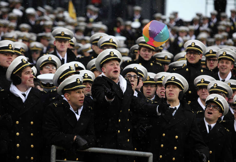 Navy midshipmen hit a beach ball through the crowd before the start of the Army Navy NCAA college football game at Lincoln Financial Field Saturday Dec. 14, 2013 in Philadelphia. (AP Photo/Jacqueline Larma) / AP