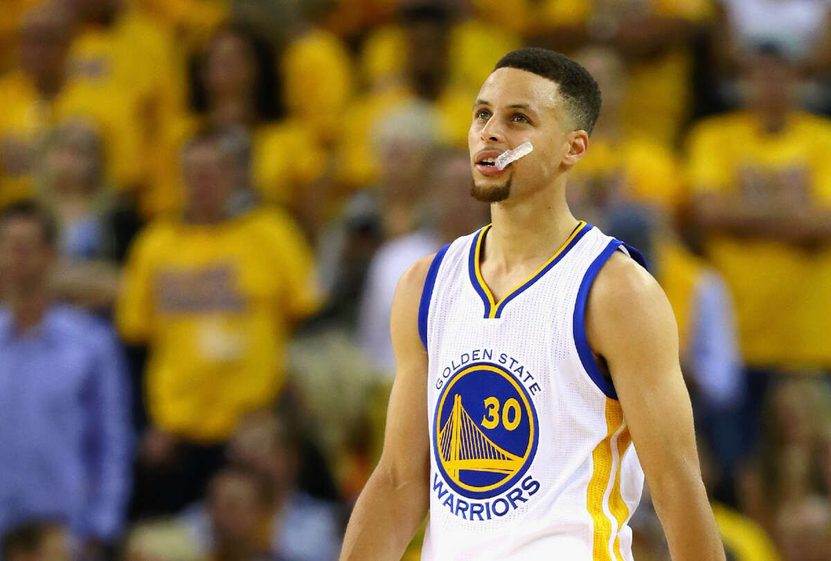 Stephen Curry chews on his mouth guard during the first half against the Cleveland Cavaliers in Game 5 of the 2016 NBA Finals at ORACLE Arena on June 13, 2016 in Oakland, California. One of Curry's game-used mouth guards will go up for auction this summer.
