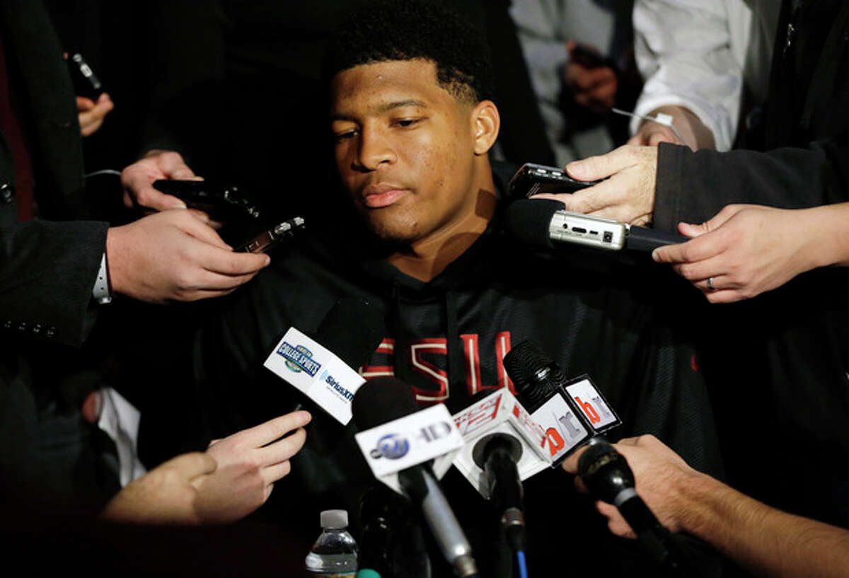 Heisman Trophy finalist Jameis Winston, a quarterback at Florida State, talks to reporters during an informal media availability, Friday, Dec. 13, 2013, in New York. (AP Photo/Julio Cortez)