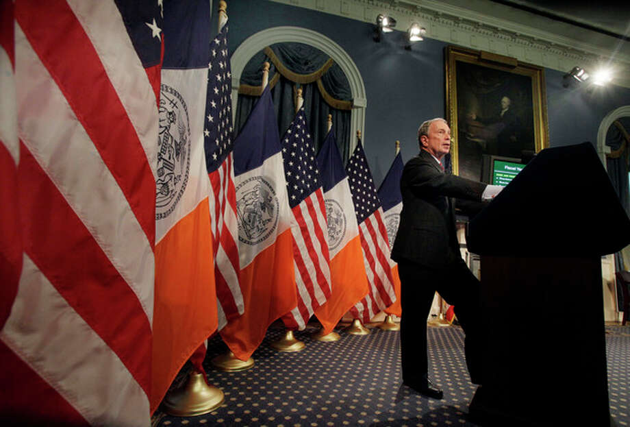 """FILE - In this May 6, 2011, file photo New York Mayor Michael Bloomberg unveiled what he called a """"budget full of difficult decisions"""" in the Blue Room of New York's City Hall. Though diminutive in stature, Bloomberg thought big, and dramatically reshaped the city, from its government to its skyline. As his three terms trickle down to their final days, he leaves as a singular figure with an unquestioned impact, but as one whose legacy is still being debated. Polls show his policies are far more popular than the man. (AP Photo/Richard Drew, Pool, File) / POOL AP"""