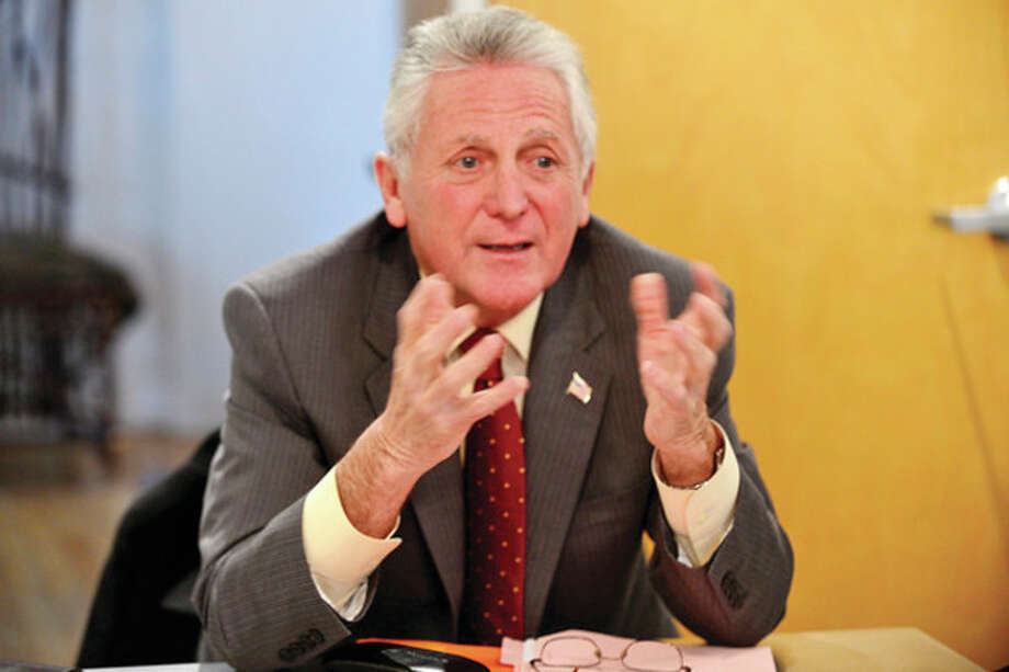 Hour photo / Erik TrautmannMayor Harry W. Rilling meets with SoNo business owners and residents at Beinfield Architecture Friday to further a conversation regarding needed improvements in the district of South Norwalk with a newly organized task force. / (C)2013, The Hour Newspapers, all rights reserved