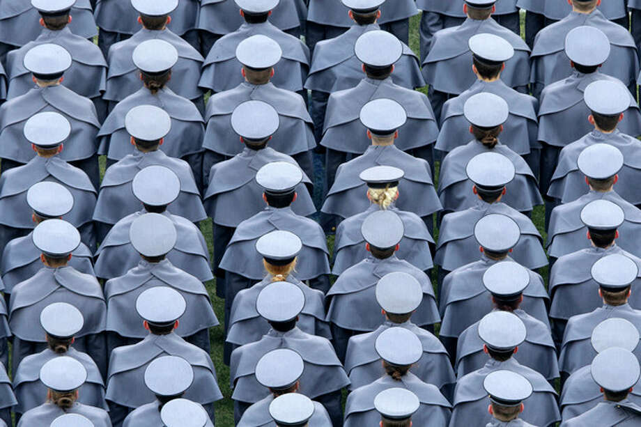 Army cadets march onto the field before an NCAA college football game against the Navy, Saturday, Dec. 14, 2013, in Philadelphia. (AP Photo/Matt Rourke) / AP