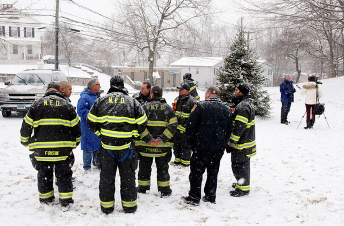 Firefighters gather during a Newtown rememberance ceremony at St. Paul's on the Green in Norwalk Saturday morning. Hour Photo / Danielle Calloway