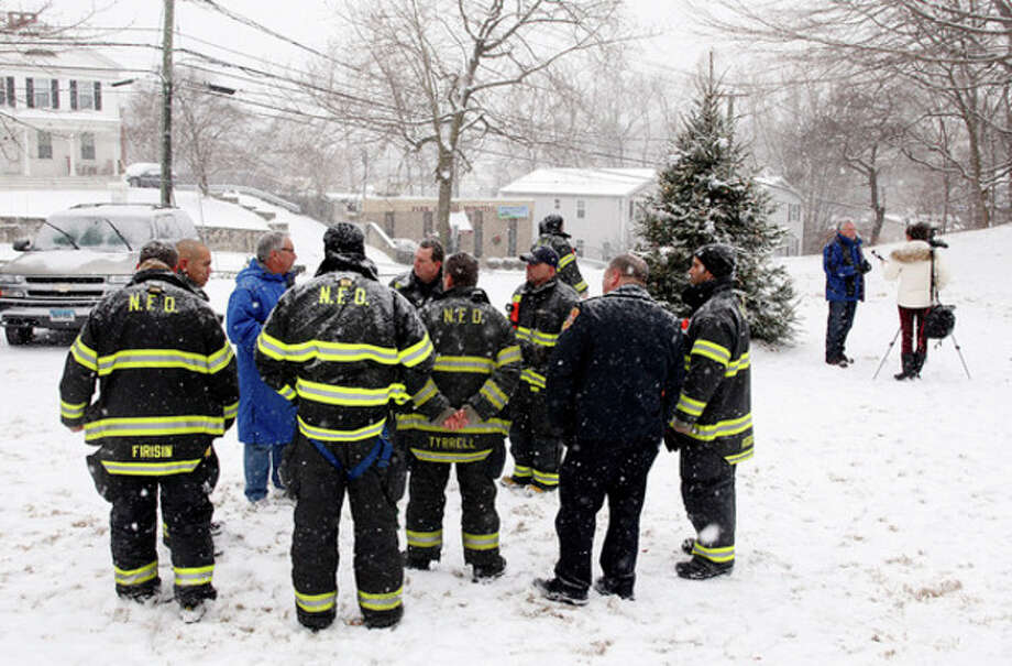 Firefighters gather during a Newtown rememberance ceremony at St. Paul's on the Green in Norwalk Saturday morning.Hour Photo / Danielle Calloway