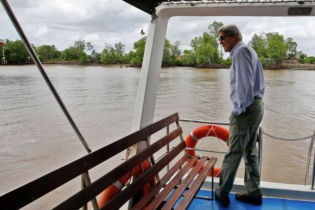 AP Photo/Brian Snyder, Pool U.S. Secretary of State John Kerry rides a boat through the Mekong River Delta Sunday, Dec. 15.