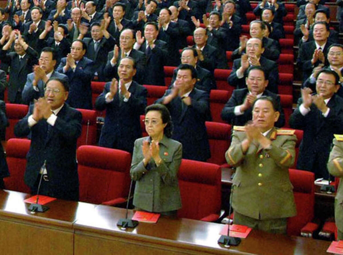 FILE - In this Sept. 28, 2010 file photo released by Korean Central News Agency via Korea News Service, Kim Kyong Hui, front row center, the aunt of North Korean leader Kim Jong Un, claps hands with other delegates during the ruling Workers' Party representatives meeting in Pyongyang, North Korea. Kim Kyong Hui has been named to an ad-hoc state committee, the country's official media reported Sunday, Dec. 15, 2013, an indication that the execution of her husband and the country's No. 2 has not immediately diminished her influence. The fate of Kim Kyong Hui - a younger sister of late leader Kim Jong Il, Kim Jong Un's father - was questioned after North Korea stunned the world Friday, Dec. 13 by announcing that her husband, Jang Song Thaek, was executed for trying to overthrow the government. (AP Photo/Korean Central News Agency via Korea News Service, File)
