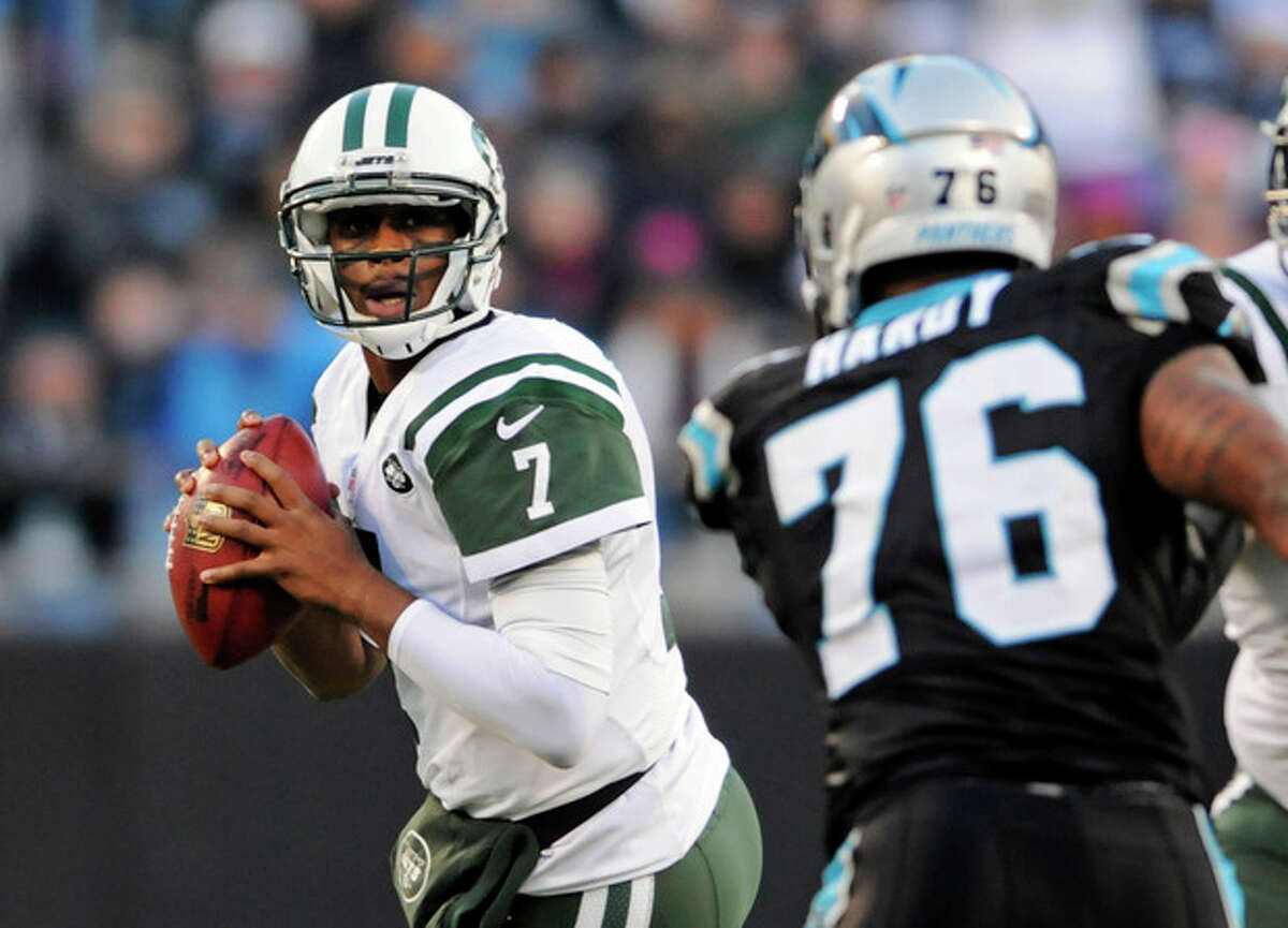 New York Jets' Geno Smith (7) looks to pass under pressure from Carolina Panthers' Greg Hardy (76) during the first half of an NFL football game in Charlotte, N.C., Sunday, Dec. 15, 2013. (AP Photo/Mike McCarn)