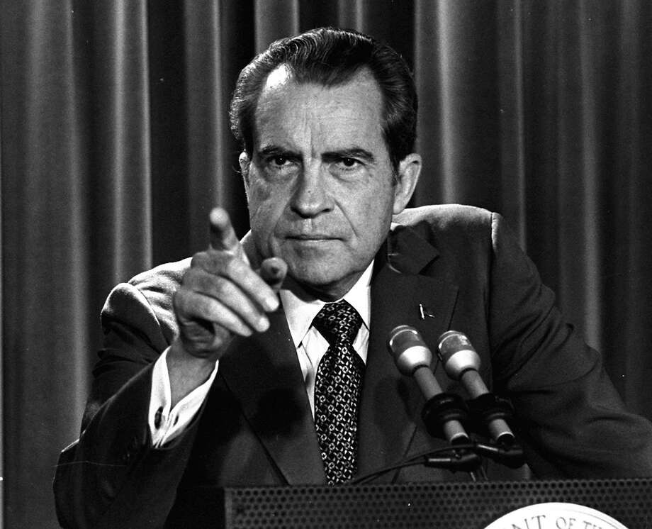 In this March 15, 1973, file photo President Nixon tells a White House news conference that he will not allow his legal counsel, John Dean, to testify on Capitol Hill in the Watergate investigation and challenged the Senate to test him in the Supreme Court. A feisty Nixon defended his shredded legacy and Watergate-era actions in grand jury testimony that he thought would never come out. On Thursday, Nov. 10, 2011, it did. (AP Photo/Charles Tasnadi, File) Photo: CHARLES TASNADI, Associated Press