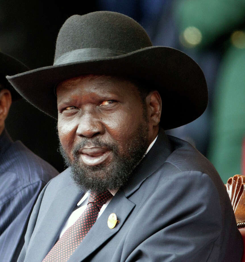 In this photo of Thursday, Dec. 12, 2013, South Sudan's President Salva Kiir, attends Keny's 50th Independence Annivarsary, in Nairobi, Kenya. Sporadic gunfire rang out early Monday, Dec. 16, 2013, in the South Sudan capital, Juba, in what a senior military official said were clashes between factions of the country's military. There has been political tension in the world's youngest nation since South Sudan President Kiir sacked Riek Machar as his deputy in July. The local Sudan Tribune newspaper reported on its website that clashes erupted late Sunday between members of the presidential guard in fighting that seemed to pit soldiers from Kiira's Dinka tribe against those from the Nuer tribe of Machar. (AP Photo/Sayyid Azim) / AP