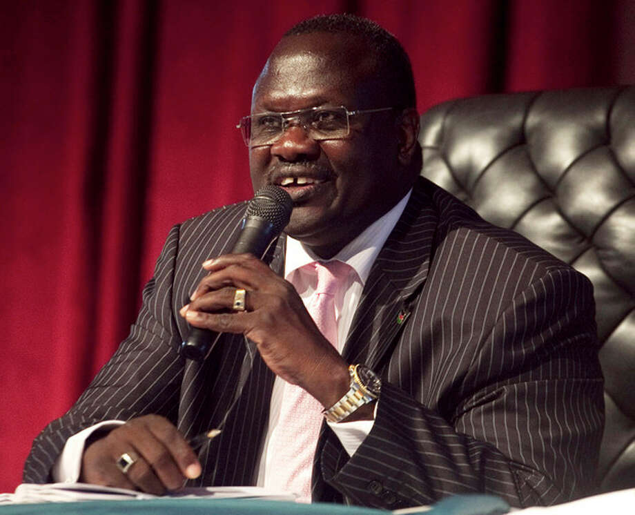FILE- In this Oct. 13 2010 file photo, Riek Machar, former Vice President of the Government of South Sudan, presides over an all-southern-parties meeting in Juba, Sudan, Sporadic gunfire rang out early Monday, Dec. 16, 2013 in the South Sudan capital, Juba, in what a senior military official said were clashes between factions of the countryÕs military. There has been political tension in the worldÕs youngest nation since South Sudan President Salva Kiir fired Machar as his deputy in July. (AP Photo/Pete Muller, File) / AP