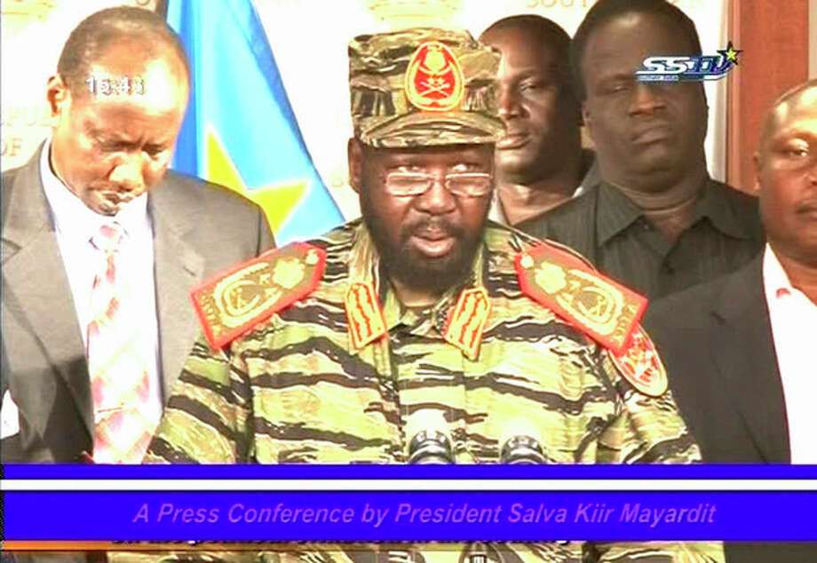 President of South Sudan Salva Kiir wearing army fatigues speaks in this still taken from a televised address in Juba South Sudan Monday Dec. 16, 2013. Kiir said that the military had foiled a coup orchestrated by / South Sudan TV via Associated Press TV