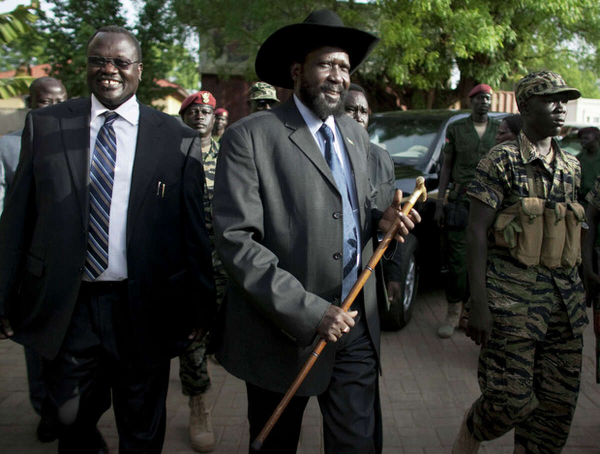FILE - In this file photo of Monday, April 26, 2010, former South Sudan Vice President ,Riek Machar, left, President of South Sudan Salva Kiir, arrive during a press conference in Juba, South Sudan. Soldiers loyal to a former vice president attempted to overthrow the government of South Sudan, the country's president said Monday, as sporadic fighting between factions of the military gripped the capital in the latest violence to hit the world's youngest nation.(AP Photo/Pete Muller-File)